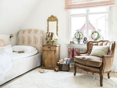 A Summer Cottage in Sweden - Home Tour - Lonny. Headboard upholstered in Raoul Textiles' Jaipur. Fabric for Roman shade also from Raoul