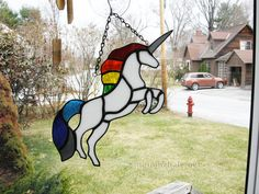 What window would not be brighter without a colorful rainbow unicorn adorning it? This handcrafted piece measures about 10.5 long by 5 wide.