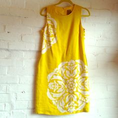 Graphic Floral Mandala Dress. Beautiful linen dress featuring a zip back, pockets, and gorgeous pattern. Sunny yellow. Lined. Taylor Dresses