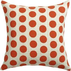 polka party.  Connect the dots for a bold graphic statement of color and texture.  Screenprinted by hand in bright red, large circles punctuate a chunky handloomed basketweave of ivory cotton flecked with glinty dashes of gold thread.  Oversized square reverses to solid white.  Do the math: CB2 low prices include a pillow insert in your choice of plush feather or lofty down-alternative (a rare thing indeed).