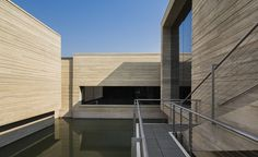 A collection of simple low-slung modernist cubes 'floating' above a lake in Wuzhen, China, is the latest cultural addition to the area's popular 'water-town' tourist resort, a maze of traditional canals with stone lanes and classic shop-houses about a...