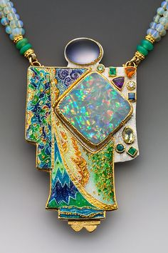 Marianne Hunter Kabuki Kachina, inspiration thrilled dances Aurora's ballet, robed in Rainbow's legs, upon Dawn's brilliant stage   | Harlequin Opal Calcedony (over parrot feather parts) Demantoid Garnet, Emerald (2) Amethyst, Yellow Diamond Sapphire, Yellow Tourmaline Paraiba Tourmaline