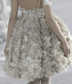 Chanel, model, runway, haute couture, couture, fashion, high fashion, Paris Fashion Week, fashion week, tulle, ruffles, lace, sheer, sparkles, layers, ball gown, silver, detail, embroidery, Karl Lagerfeld, couturier, atelier, fashion designer, designer, Coco Chanel, pearls, metallic, organza, delicate, white,