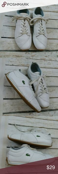 LaCoste White Leather Alligator Sneakers US 8.0 This is a great pair of Lacoste ladies leather white sneakers. They are ladies size 8.0. They are in great preowned condition and sold without stop flaws or stains. Lacoste Shoes Sneakers