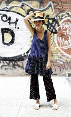 A panama hat is worn with a polka-dot dress, printed pants and statement earrings.