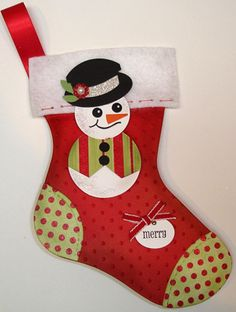 The Sizzix Stocking die from Stampin' Up! and the punches for the snowman.
