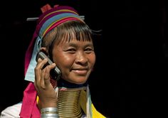 Long neck woman with mobile phone, Thailand