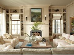 Pretty living room all in neutral. Love the shelving design on each side of the windows. Great use of space and way to display treasured items.    My Sweet Savannah