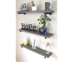This reclaimed wood floating shelf will compliment modern and rustic decors alike. It is supported by industrial pipes and fittings and provides for the perfect urban industrial look. It is 8 inches deep (wood 7.25 inches deep and approximately 1.5 inches thick).  It is available in 3 colors: weathered gray, ebony, or special walnut.  This price is per shelf and it includes 1 shelf, 2 pipe brackets and mounting screws. Length: 16, 24, 36 or 48 Depth: 8   ReclaimedWoodUSA is a family owned…