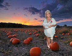 Paula Deen took a chicken to a pumpkin patch! Silly woman!