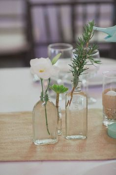 antique medicine bottles for flowers on tables. bought at antique and flea markets #wedding reception  http://ohanablog.com/jillian-curiel-and-james-schroeder-wedding-at-the-thursday-club-in-san-diego-by-ohana-photographers-pt1/