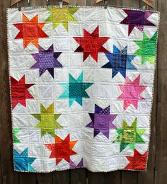 """modern wonky star kids quilt.  wombat quilts. I love the fabric variance in the stars, which were made using 5"""" squares, and the link also has other ideas for 5"""" squares."""