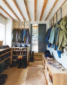 A mudroom Especially one filled with riding boots. Brooks's Boot Room features vintage military prints from a Paris flea market and limestone flooring from a quarry on the farm. Designated cubby holes and shelving complete the look.