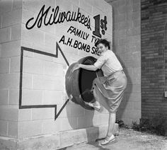 Marie Graskamp of Milwaukee shows people how to potentially enter a bomb shelter, should one be necessary. Rare Historical Photos, Bomb Shelter, Military Girlfriend, Military Spouse, Family Tv, Fallout New Vegas, Atomic Age, Native American History, British History