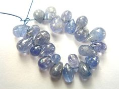 Tanzanite Smooth Drops (Quality B) / 3x4 to 5x7 mm / 5 cm / 14.85 carats / 23 pieces / ST-2475 by beadsofgemstone on Etsy