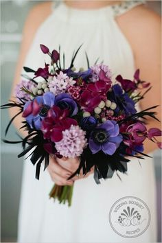 Fuchsia Orchids, Blue-Violet Anemones, Lavender Lilac, Silver Brunia, Fuchsia Waxflower, Black Feathers