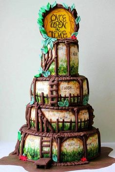 Once Upon a Time Cake done by cake artist Yisel RamirezSeda an awesome and talented baker AND cake artist. Her shop, Beyond Delights, is located in Ft. Still, Ok... phone # is (580)728-5682. https://www.facebook.com/yisella.ramirezseda