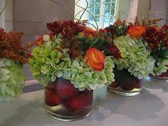 apples in the container with fall roses, hydrangea, daises, berries and curly willow