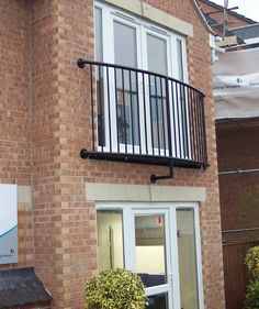 Curved tubular design juliet balcony railing Lincoln.