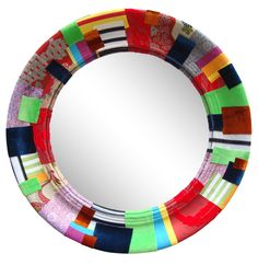Fabric wrapped mirror using silks velvets and cottons by Squint Limited
