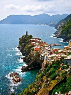 "Vernazza, Cinque Terre, Liguria, Italy - The Cinque Terre is a rugged portion of coast on the Italian Riviera. It is in the Liguria region of Italy, to the west of the city of La Spezia. ""The Five Lands"" is composed of five villages: Monterosso al Mare, Vernazza, Corniglia, Manarola, and Riomaggiore. The coastline, the five villages, and the surrounding hillsides are all part of the Cinque Terre National Park and is a UNESCO World Heritage Site."