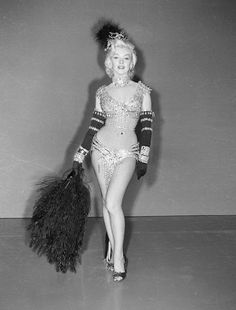 "Marilyn In the original William Travilla dress for ""Diamonds are a Girl's Best Friend"" from ""Gentleman Prefer Blondes"", 1953. The design was replaced by the pink Travilla design with the orders to ""cover her up""."