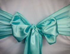 Chair Rentals- Turquoise Satin Chair Sash. Complete the look with a matching table runner or napkin. Check out our other fabrics at Eventrentalutah.com or follow our board on Pinterest