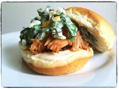slow-cooked pork and kale coleslaw with preserved lemon piled on potato rolls
