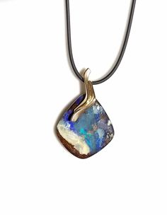 yellow gold gracefully accents a stunning boulder opal in this pendant made by Wisconsin artist Whitney Robinson. Available at Studio Jewelers. Handcrafted Jewelry, Wisconsin, Bridal Jewelry, Jewelry Crafts, Opal, Pendant Necklace, Jewels, Studio, Yellow