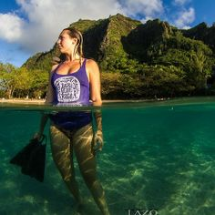 Beautiful Ke'e Beach with Logan in her purple Lucky We Live Hawaii tank