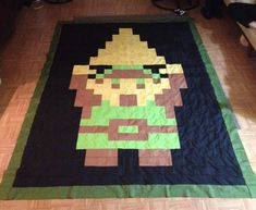 One thing I'm a geek over is the Legend of Zelda series, and making crafts based off of the series. I'm so obsessed with both crafting AND Zelda, that I made a quilt of Link with the triforce! It show my obsession for both Legend of Zelda AND crafting!