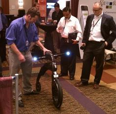 Shaun Ryan, CEO of SLI Systems trying out a Yike Bike