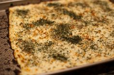 Cauliflower Pizza Bread: Preheat oven to 450. In a bowl, mix together your cooked, riced cauliflower, eggs, and mozzarella. Spread dough mixture onto a baking sheet or pizza pan. Add Herbs. Cook in over for 15-20 minutes.