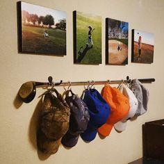 Golf Club hat rack and midge podge photo canvases.