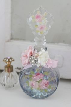A beautiful glass scent bottle.love the petite scent bottle with the gem… Perfumes Vintage, Antique Perfume Bottles, Vintage Bottles, Bottles And Jars, Glass Bottles, Motifs Roses, Beautiful Perfume, Altered Bottles, Bottle Art
