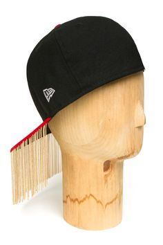 I love this Fringe Cap by Kye.  It's fun!