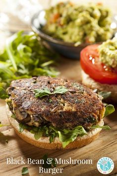 A hearty black bean & mushroom burger on a bed of lettuce. Perfect for outdoor grilling. Bakerette.com (#vegan #vegetarian #eggfree)