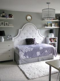 Twin size bed turned sideways on bigger headboard. So cute for a girl's room.