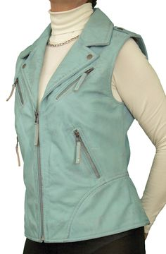 Stylish and classy biker-style womens leather gilet in sky blue soft lambskin nappa. Metal zips on front pockets and at back hem. Also in wine red, mustard yellow and black. Attractive floral print lining. Great for smart-casual wear with anything - leggings, trousers, jeans, shorts or skirt!