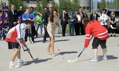 Dropping a puck  No referee attire required. Kate gracefully dropped a hockey puck during a match in Canada — not an easy task in high heels.