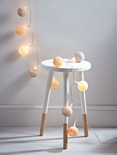 Our stylish pompom string lights are made up of twenty warm white bulbs encased in large spun cotton globes. Each garland includes delicately spun cotton globes in three neutral shades that cast a soft glow across the room when lit. Hang around a bed frame, bundle into a vase or take a look at our blog for ideas on how to incorporate lighting into your home.