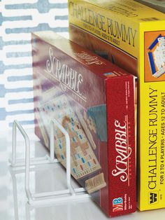 Organize board games and puzzles with a rubber-coated wire pan rack.