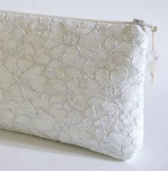 White Lace Clutch, Lace Wedding Clutch, Bridesmaid Gift, White Glitter Bag, Graduation Handbag, Birthday Gift for Her by PersaBags on Etsy https://www.etsy.com/listing/188937803/white-lace-clutch-lace-wedding-clutch
