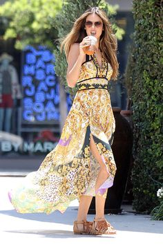 Alessandra Ambrosio – this supermodel sure knows how to turn a candid / stolen snapshot into something worthy of a page in a magazine or some billboard space. Here we see Alessandra wearing that dreamy printed maxi dress along with tasseled tan sandals and an iced tea in her hand. Yes, she makes iced tea look so fancy.