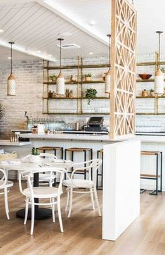 Cérused wood flooring inside a white and rustic kitchen