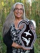 """Iroquois Raised Beadwork is a unique style of Native American beadwork. It is noted for its embossed or """"raised"""" application of tiny seed beads on a velvet background. Karen Ann Hoffman is a member of the Oneida Nation of Wisconsin"""