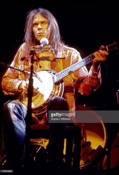 Foto di attualità : Canadian singer Neil Young performs on stage,...