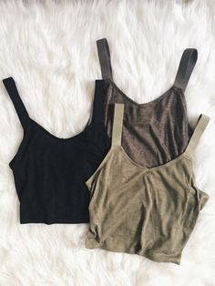 Rib knit, cropped, tank top with wide straps. 65% Poly 35% Rayon