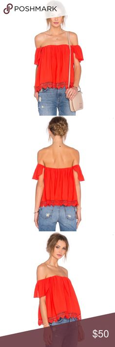 NWT Lovers And Friends Off-The-Shoulder Top NWT Lovers And Friends Life's-A-Beach Off-The-Shoulder Blouse in Red Orange.  Off-the-shoulder neckline. Short sleeves. Relaxed silhouette. Scalloped hem. Rayon/viscose. Polyester lining. Lovers + Friends Tops Blouses