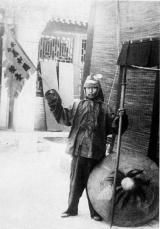 """A Boxer in regalia during the Boxer Rebellion, China, 1898-1901. At the turn of the 20th century, intense social pressure due to increasing foreign influence in Qing China led to an upsurge of participation in the Righteous Harmony Society Movement (Yihetuan), called the """"Boxers"""" by foreign observers. From their base in drought-ravaged northern China, the Boxers spread across the country, attacking foreign missionaries, diplomats and traders, as well as Chinese Christian converts."""